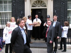 Joe gives box of petition sheets to Downing Street official