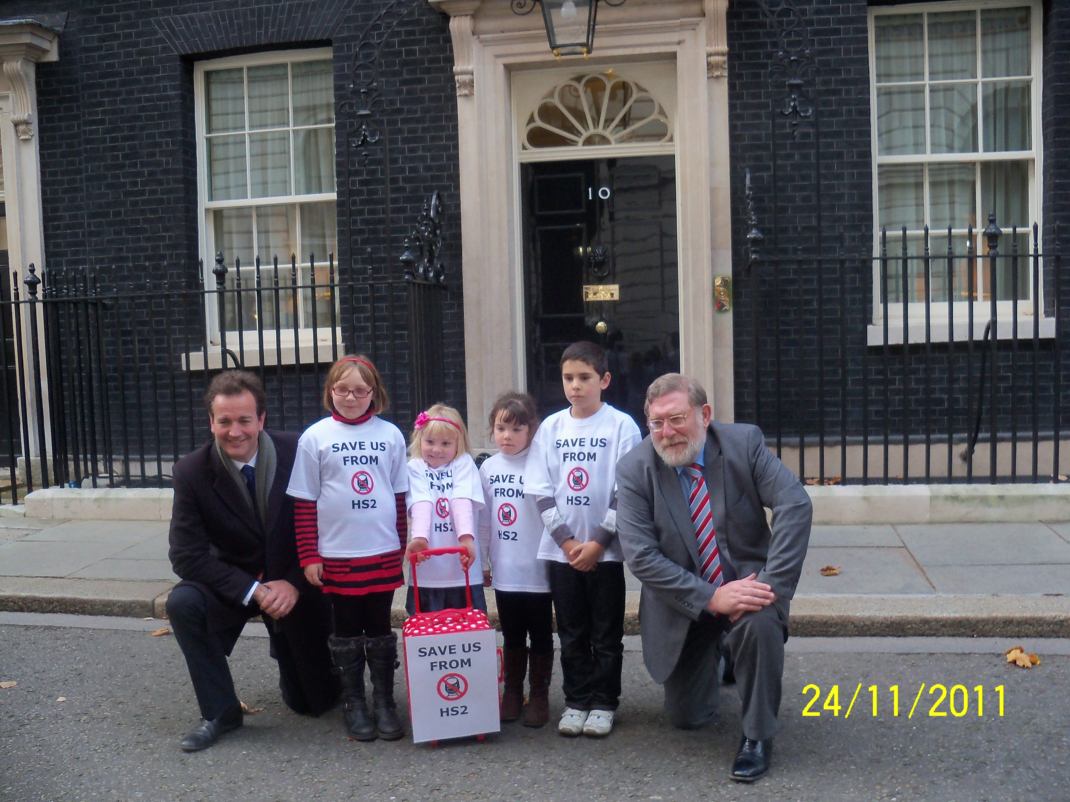 John Randall MP and Nick Hurd MP help deliver the kids 'Save us from HS2' petition to Downing St