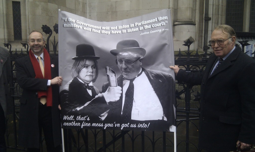 Martin Tett and Nick Rose (leaders of Buckinghamshire County and Chiltern District Councils) hold up a banner depicting Justine Greening and Patrick McLoughlin as Laurel and Hardy
