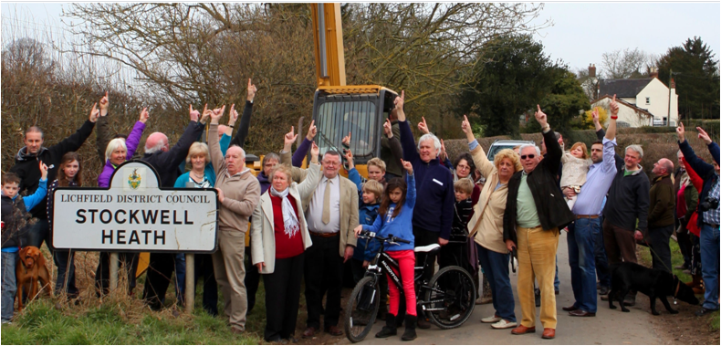 Stockwell Heath residents, standing on road, pointing at sky