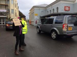Protester in Dawlish greets David Cameron