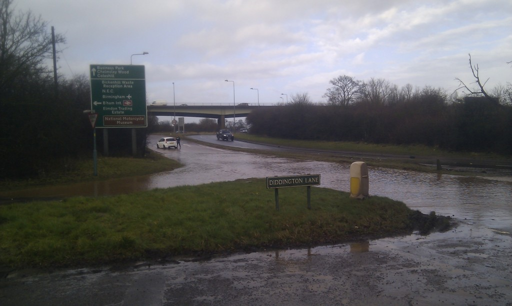 A stranded motorist regrets chancing it through the flooded A452