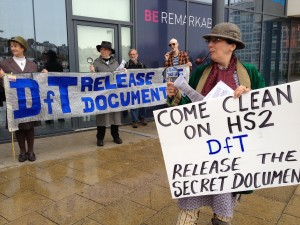 Sherlock Holmes searches for secret HS2 documents at rail summit in Hastings, watched by Miss Marple, Inspector Poirot and Kojak. 31 Mar 2014 (credit: Coombe Haven Defenders)