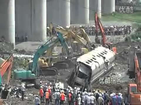 Burying bad news - Diggers line up to bury a carriage from the Wenzhou crash in 2011